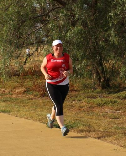 Looking tired, hot but happy on the return leg. Photo courtesy of Toolern Creek parkrun